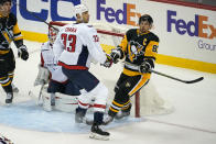 Washington Capitals' Zdeno Chara (33) defends against Pittsburgh Penguins' Sidney Crosby (87) during the first period of an NHL hockey game in Pittsburgh, Sunday, Jan. 17, 2021. (AP Photo/Gene J. Puskar)
