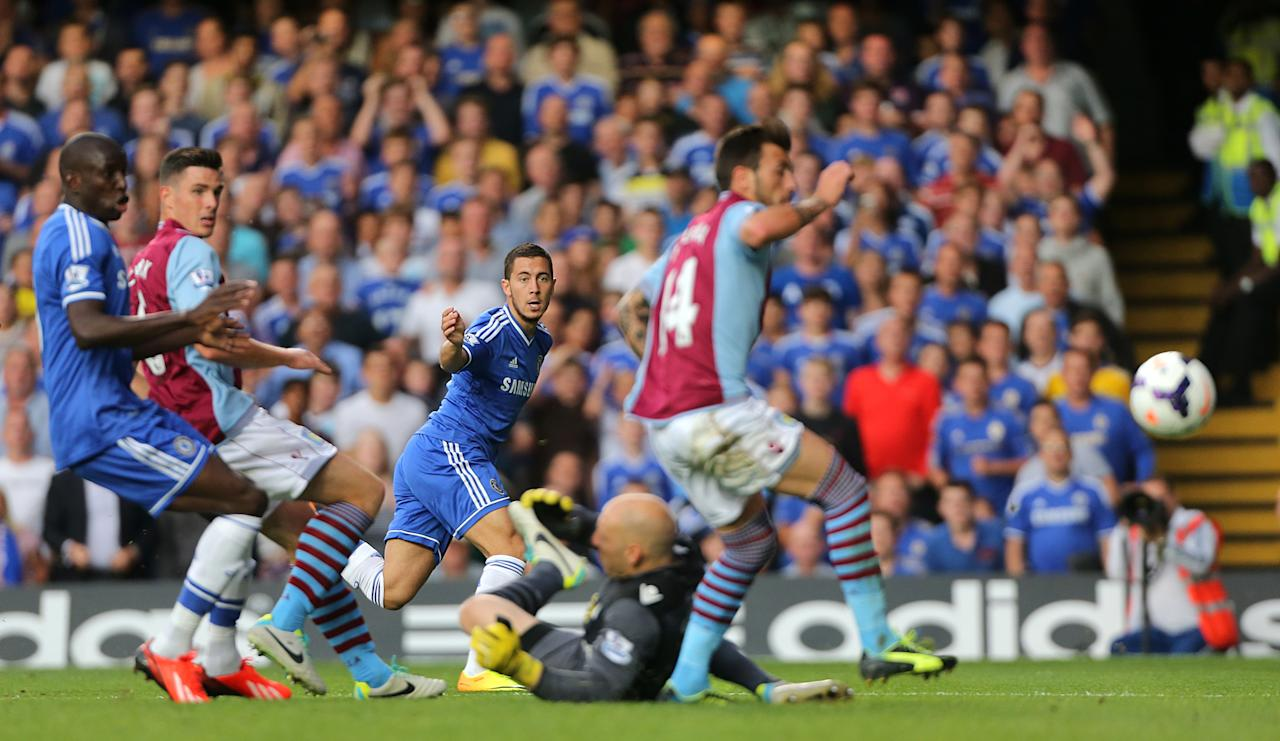 Chelsea's Eden Hazard has a shot on goal which is turned into his own net by Aston Villa's Antonio Luna (centre right)