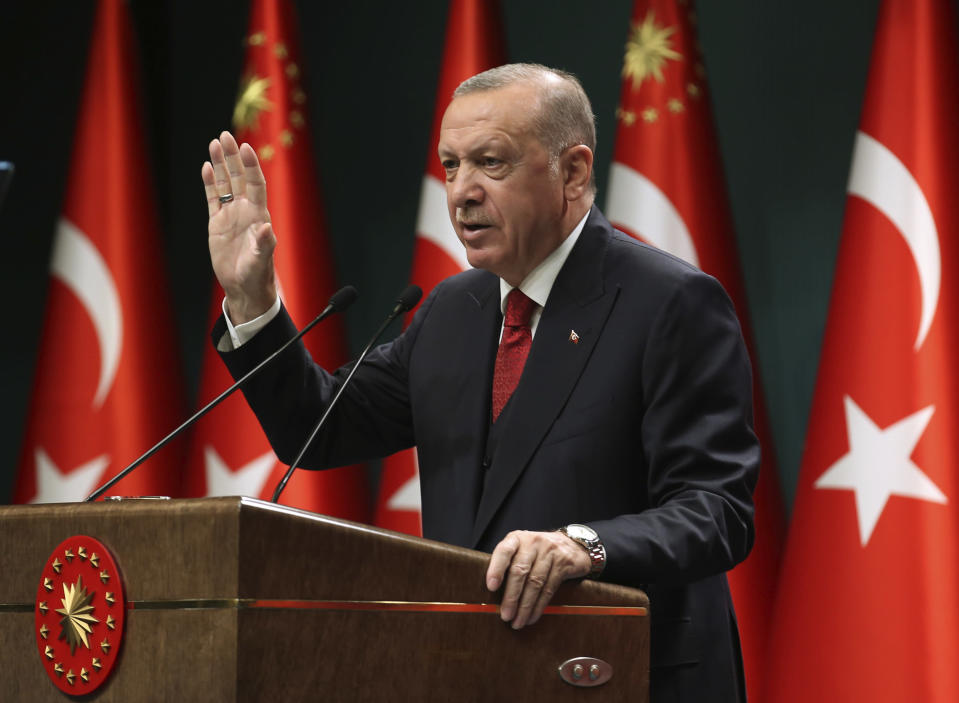 "Turkey's President Recep Tayyip Erdogan, talks in a televised address, following a cabinet meeting, in Ankara, Turkey, Monday, Sept. 21, 2020. Erdogan, who has long called for a reform of the United Nations, says the world body has failed in its response to the coronavirus pandemic. Erdogan claimed the UN was late in ""accepting the existence"" of the pandemic and had failed to ""make its presence felt"" for nations requiring help to fight infections. (Turkish Presidency via AP, Pool)"