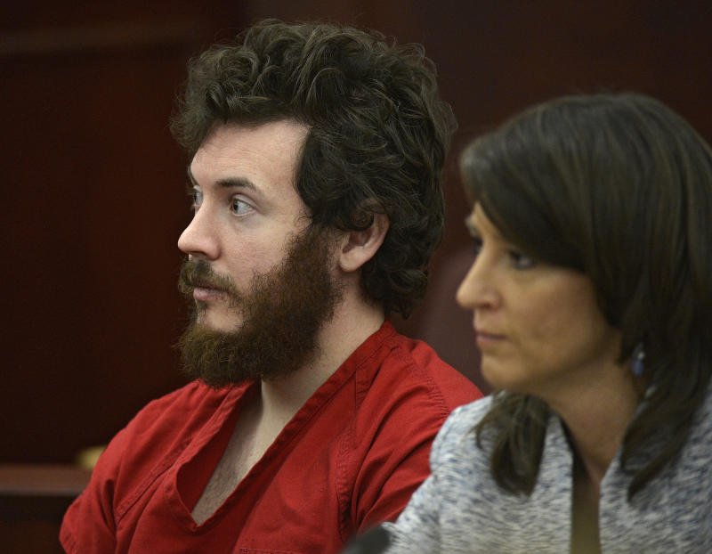 FILE - In this March 12, 2013 file photo, James Holmes, left, and defense attorney Tamara Brady appear in district court in Centennial, Colo. for his arraignment.  Holmes, the suspect in the Colorado theater massacre, could enter his long-expected insanity plea at a hearing Tuesday June 4, 2013, though the case could also veer off on another tangent as his lawyers seek the strongest possible defense. (AP Photo/The Denver Post, RJ Sangosti, Pool, File)