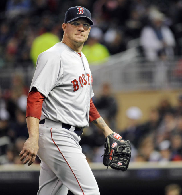 Boston Red Sox starting pitcher Jake Peavy (44) walks to the dugout after being pulled against the Minnesota Twins during the fifth inning of a baseball game in Minneapolis, Tuesday, May, 13, 2014.(AP Photo/Craig Lassig)