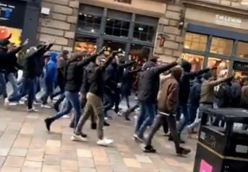 Lazio fans make Roman salute as they march in Glasgow ahead of their side's Europa League match against Celtic.