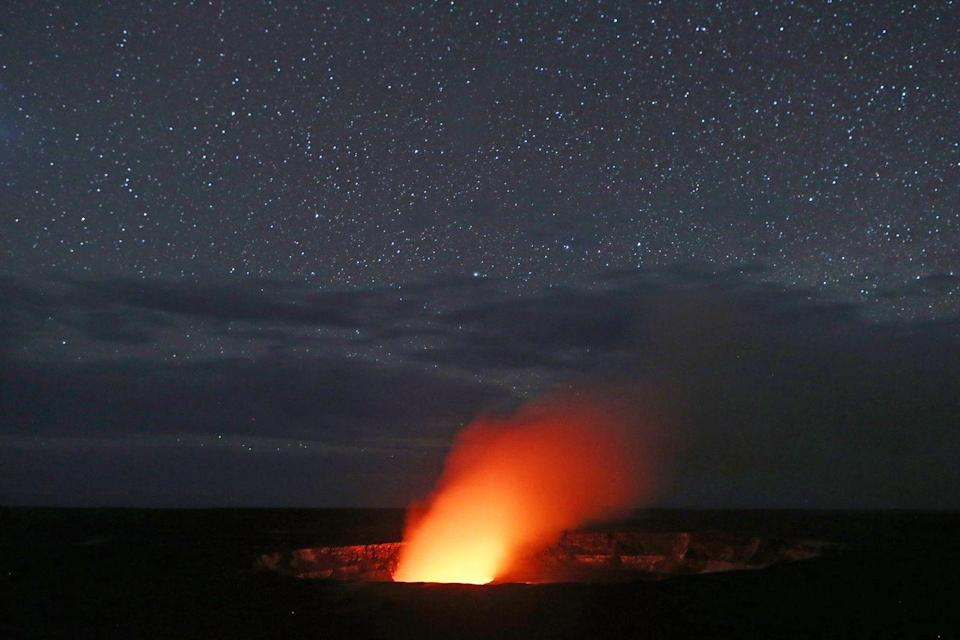 <p>A cloud of smoke rises from the center of a volcano in the Hawaii Volcanoes National Park // May 9, 2018</p>