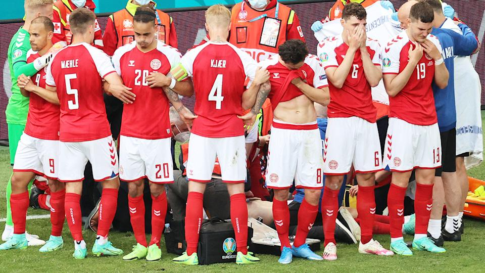 Denmark players, pictured here gathering as paramedics attend to Christian Eriksen.