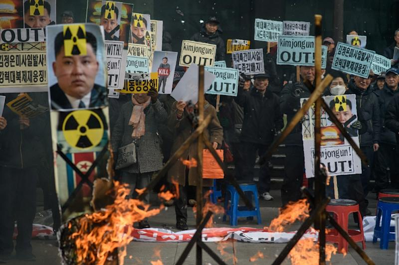 Anti-North Korean activists protest nuclear test and a rocket launch by Pyongyang, in Seoul, in February 2016 (AFP Photo/Ed Jones)