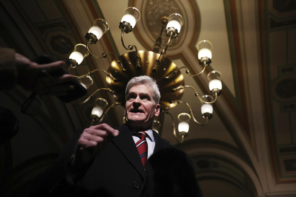Sen. Bill Cassidy, R-La., talks with reporters as he leaves the U.S. Capitol after the first day of Trump's second impeachment trial in the Senate, Tuesday, Feb. 9, 2021, in Washington. (Chip Somodevilla/Pool via AP)
