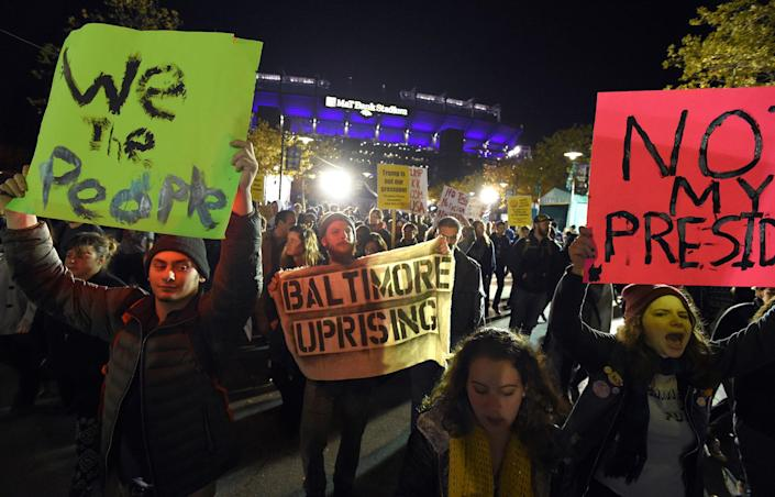 <p>Anti-Trump protesters make their way to M&T Bank Stadium during the Baltimore Ravens vs. Cleveland Browns football game Thursday, Nov. 10, 2016, in Baltimore. (Photo: Lloyd Fox/The Baltimore Sun via AP/AP) </p>