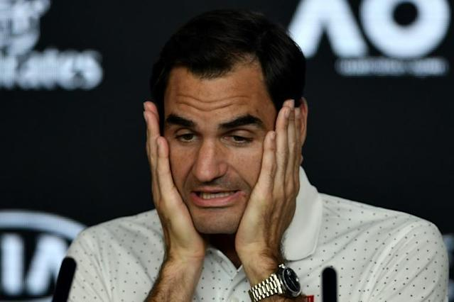 Switzerland's Roger Federer said there was confusion among players over the Australian Open's air pollution policy (AFP Photo/Manan VATSYAYANA )