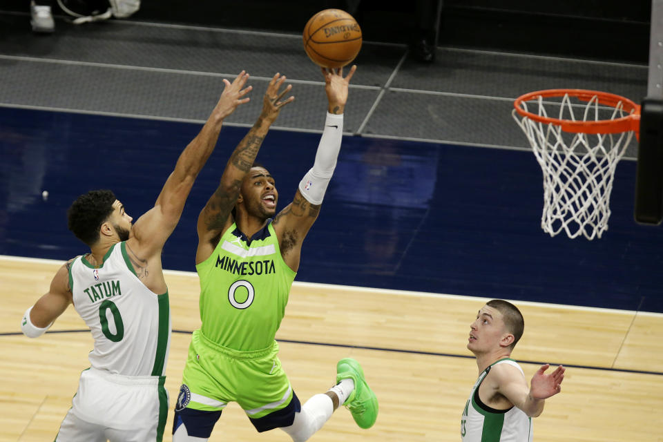 Minnesota Timberwolves guard D'Angelo Russell (0) shoots in front of Boston Celtics forward Jayson Tatum (0) and guard Payton Pritchard (11) in the first quarter during an NBA basketball game, Saturday, May 15, 2021, in Minneapolis. (AP Photo/Andy Clayton-King)