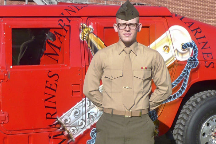 """This January 2009 photo provided by Charlene Bigelow shows her son, Devin Lynch, during his Marine graduation from Parris Island, S.C. In February 2016, Lynch had gotten drunk and attempted suicide. He was arrested the same day on charges alleging he sexually assaulted his girlfriend and was jailed awaiting trial. He suffered from depression and anxiety and had post-traumatic stress disorder after serving with the Marines for almost eight years, including deployments to Afghanistan and Japan on a mission to collect human remains after the 2011 tsunami, according to his mother and court records. Bigelow believes her son's death was preventable and hopes her lawsuit helps ensure suicide-prevention policies are carried out. Her son, she says, """"would want to hope that his story would make a difference in somebody else's life."""" (Charlene Bigelow via AP)"""