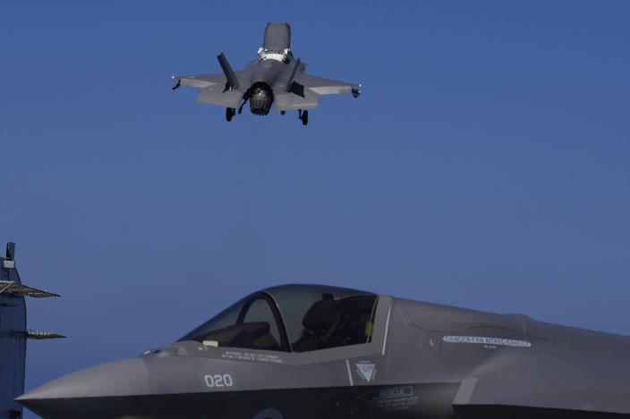"""F-35 aircraft takes off from the U.K.'s aircraft carrier HMS Queen Elizabeth in the Mediterranean Sea on Sunday, June 20, 2021. The British Royal Navy commanders say the U.K.'s newest aircraft carrier HMS Queen Elizabeth is helping to take on the """"lion's share"""" of operations against the Islamic State group in Iraq as Russian warplanes get an up-close look at the cutting-edge F-35 jet in a """"cat-and-mouse"""" game with British and U.S. pilots. (AP Photo/Petros Karadjias)"""