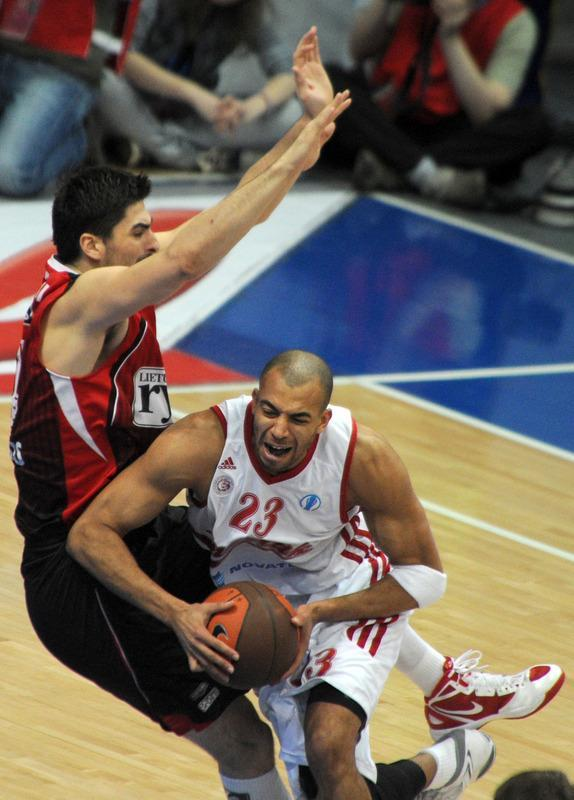 Lietuvos Rytas' Predrag Samardziski (L) vies with BC Spartak Saint-Petersburg's Victor Keyru during Eurocup's FinalFour third place basketball match between Lietuvos Rytas and BC Spartak Saint-Petersburg in Khimki, a suburb of Moscow, on April 15, 2012. (Photo by Kirill Kudryavtsev /AFP/Getty Images)