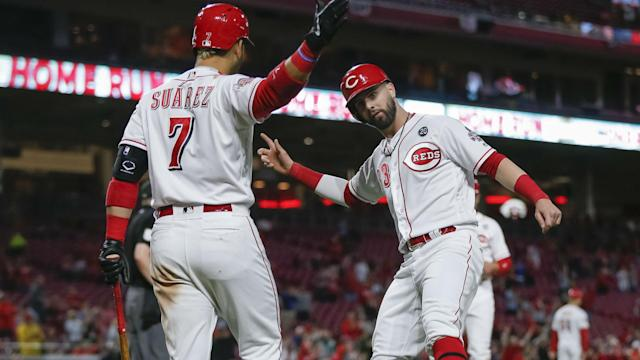 The Cincinnati Reds pulled off an impressive victory on Tuesday, using a seven-run sixth inning to top the Miami Marlins, 14-0.