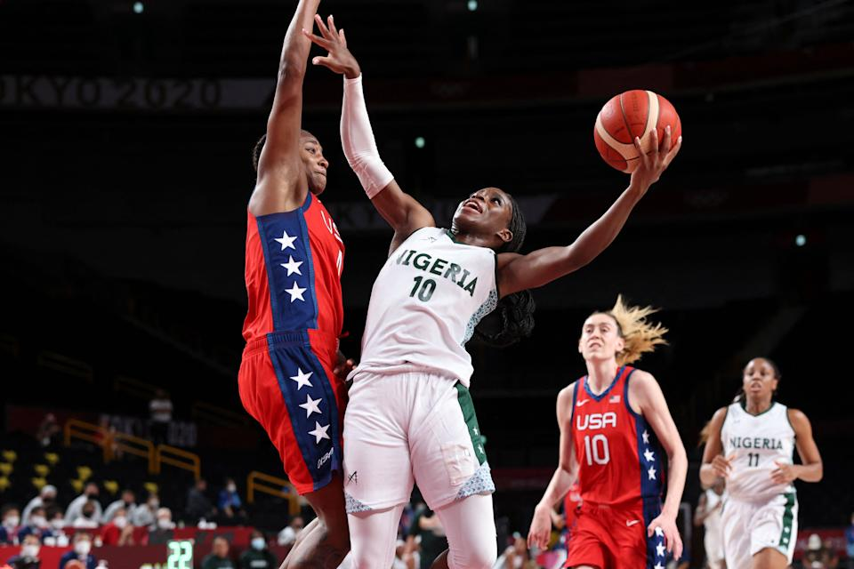 Nigeria's Promise Amukamara goes to the basket past USA's Jewell Loyd (L) in the women's preliminary round group B basketball match between Nigeria and USA during the Tokyo 2020 Olympic Games at the Saitama Super Arena in Saitama on July 27, 2021. (Photo by Thomas COEX / AFP) (Photo by THOMAS COEX/AFP via Getty Images)