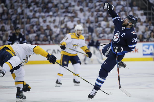 Nashville Predators' Matt Irwin, left, and Winnipeg Jets' Blake Wheeler (26) collide during the second period of Game 4 of an NHL hockey second-round playoff series in Winnipeg, Manitoba, Thursday, May 3, 2018. (John Woods/The Canadian Press via AP)