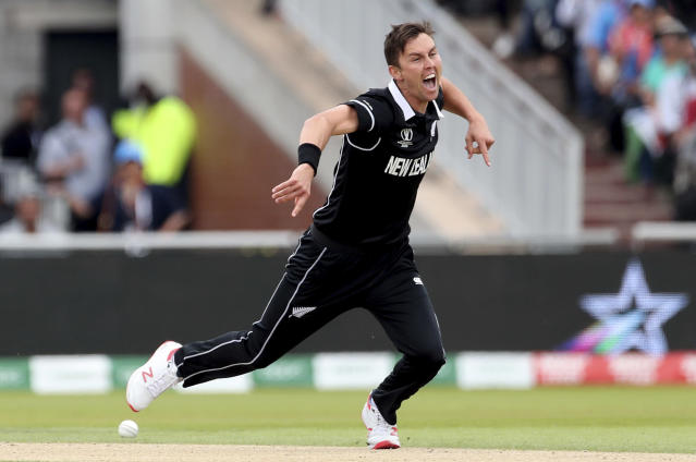 Zealand's Trent Boult celebrates the dismissal of India's captain Virat Kohli during the Cricket World Cup semi-final match between India and New Zealand at Old Trafford in Manchester, England, Wednesday, July 10, 2019. (AP Photo/Aijaz Rahi)