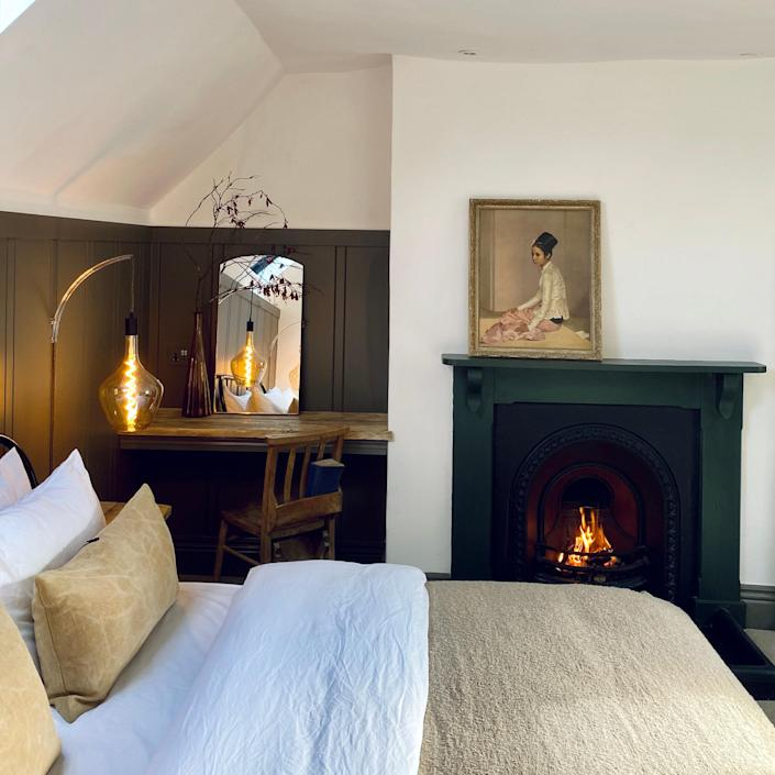 One of the first bedrooms to be completed in the makeover reveal, this skylighted bedroom is in the 16th-century caretaker's cottage and features modern elements within the traditional space.