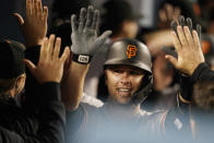 San Francisco Giants' Buster Posey celebrates his three-run home run with teammates in the dugout during the eighth inning of a baseball game against the Los Angeles Dodgers Friday, May 28, 2021, in Los Angeles. (AP Photo/Marcio Jose Sanchez)