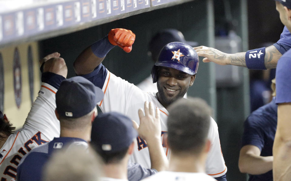 Houston Astros' Yordan Alvarez celebrates in the dugout after hitting a home run against the Oakland Athletics during the second inning of a baseball game Monday, Sept. 9, 2019, in Houston. (AP Photo/David J. Phillip)