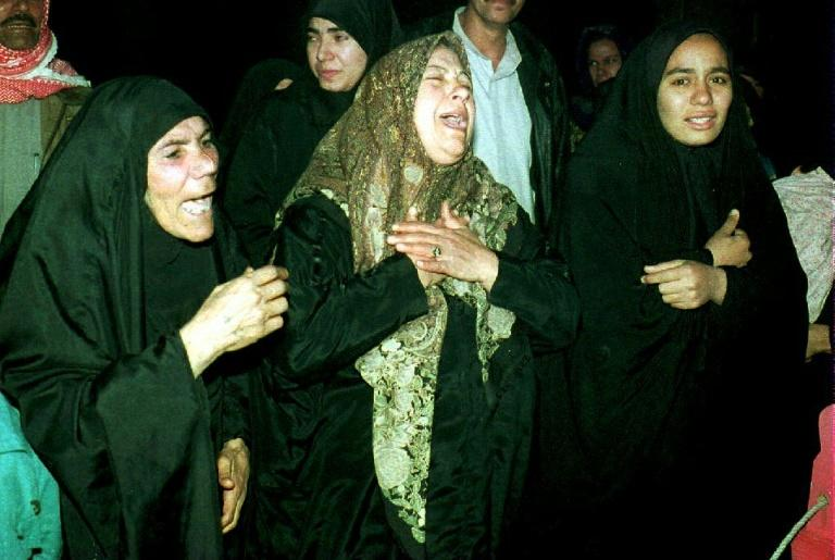 Iraqi women mourn the people killed in the US missile attack on Baghdad 27 June, 1993