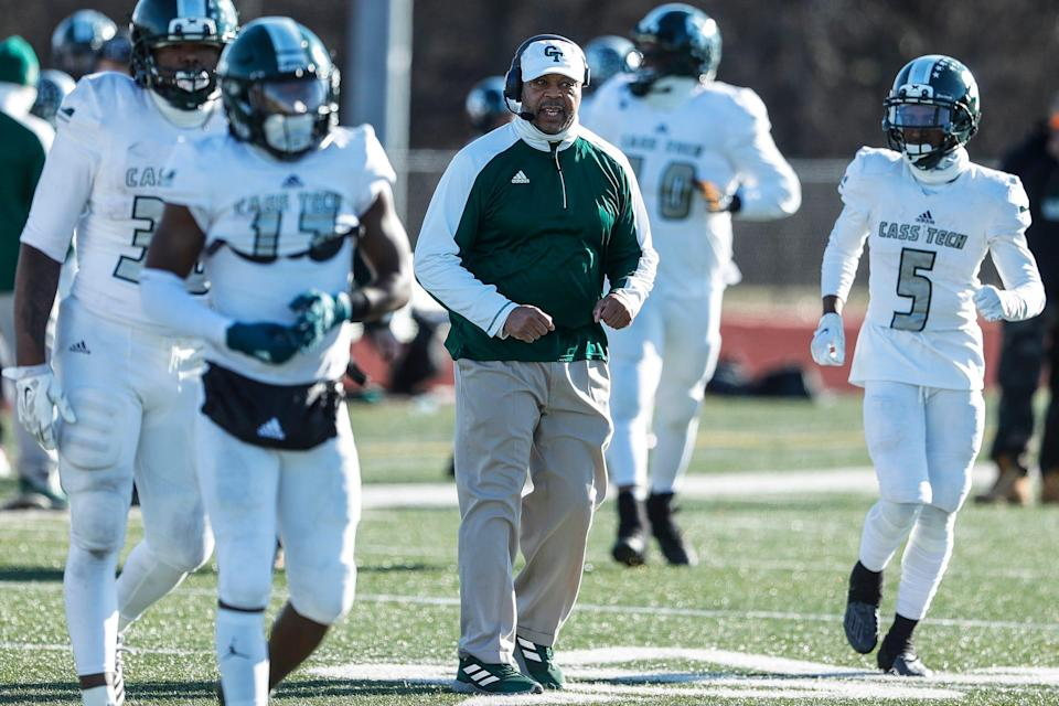 Detroit Cass Tech coach Thomas Wilcher with players during the first half against Belleville at Belleville High School on Saturday Jan. 9, 2021.