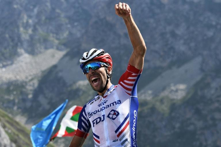 France's Thibaut Pinot raises his fist in victory after stage 14