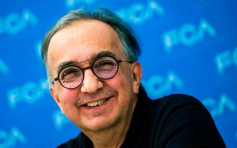 Sergio Marchionne, Chief Executive Officer of Fiat Chrysler Automobiles (FCA), smiles as he answers a question during a press conference at the 2018 North American International Auto Show (NAIAS) in Detroit, Michigan, on January 15, 2018. The Detroit Auto Show got rolling on January 14, with international trade and tax cuts dominating the conversation, even as carmakers raced to meet Americans' seemingly insatiable appetite for trucks and SUVs. / AFP PHOTO / Jewel SAMADJEWEL SAMAD/AFP/Getty Images - Credit: JEWEL SAMAD /AFP
