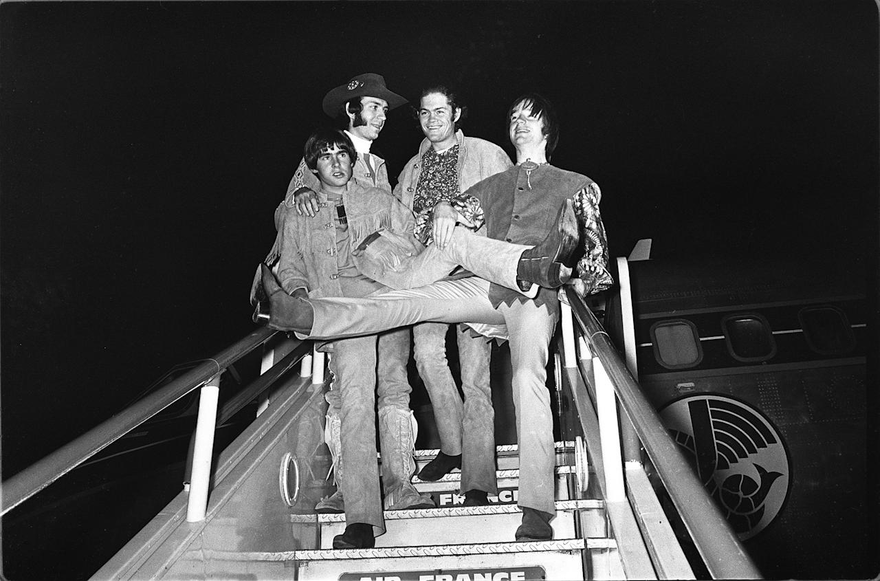 American pop group, the Monkees, pictured on arrival at London Airport, 28th June, 1967. Arriving from Paris, the group will perform a live stage show at the Empire Pool, Wembley, this coming weekend. Left to right are Davy Jones, Peter Tork, Micky Dolenz and Mike Nezsmith. (AP photo).