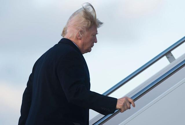 President Trump vs. the wind. (Photo: Getty Images)