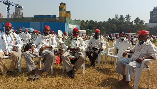 Madhav Tumbde (left) sits with a group of farmers from Nashik. Firstpost/Natasha Trivedi