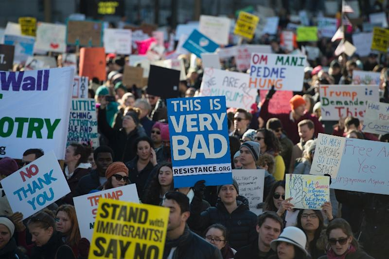 Protesters march on Pennsylvania Avenue while protesting against US President Donald Trump's recent action on refugees entering the US (AFP Photo/MOLLY RILEY)