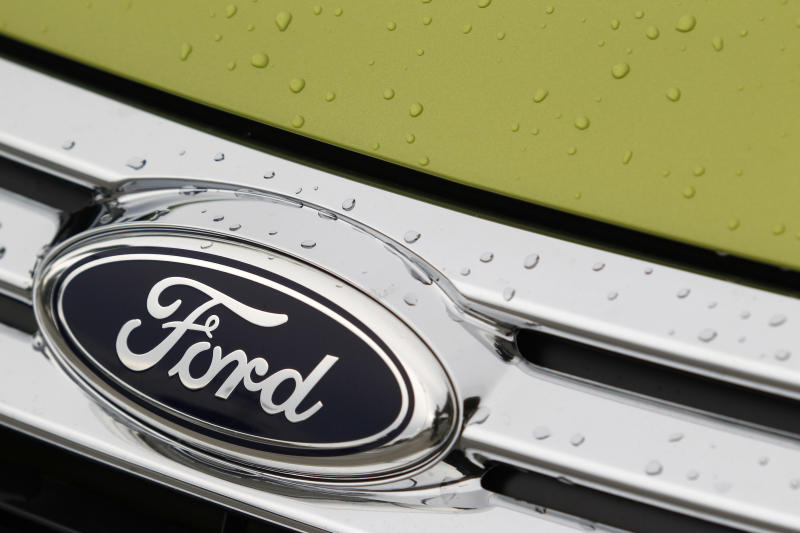 FILE - In an Aug. 31, 2011 file photo raindrops are on the grill of a 2012 Ford Fiesta SE at the Maroone Ford of Miami dealership. Ford Motor Co. said Wednesay July 25, 2012, its net income fell by 57 percent to $1 billion in the second quarter as losses in Europe and Asia mounted. (AP Photo/Wilfredo Lee/file)