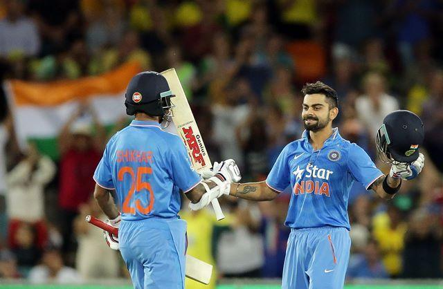 Kohli being congratulated by Dhawan after scoring a century