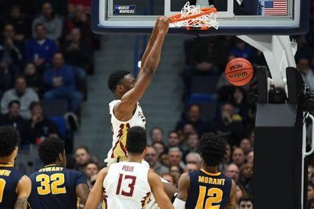 Mar 23, 2019; Hartford, CT, USA; Florida State Seminoles forward Mfiondu Kabengele (25) dunks and scores against the Murray State Racers during the second half of game in the second round of the 2019 NCAA Tournament at XL Center. Mandatory Credit: Robert Deutsch-USA TODAY Sports