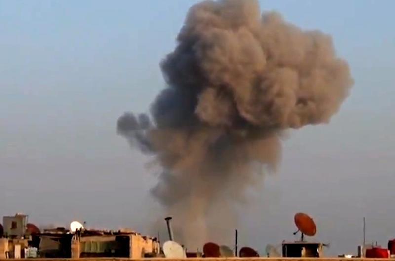 In this image taken from video obtained from the Shaam News Network, which has been authenticated based on its contents and other AP reporting, smoke rises from buildings from heavy shelling in Damascus, Syria, on Thursday, Dec. 27, 2012. (AP Photo/Shaam News Network via AP video)