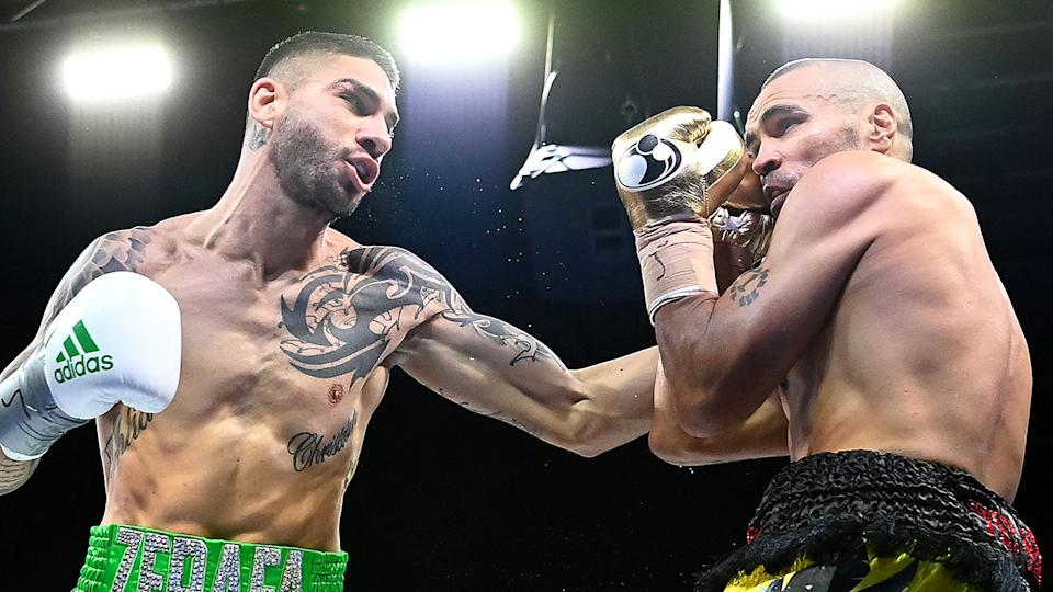 Pictured here, Anthony Mundine gets set to cop a punch from Michael Zerafa in their boxing bout.