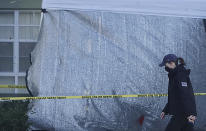 Law enforcement personnel continue to work at an apartment complex the day after a deadly shooting in Sunrise, Wednesday, Feb. 3, 2021. Several FBI agents were killed and others were wounded while trying to serve a search warrant on a child pornography suspect in Florida. FBI authorities say the suspect also died. (Joe Cavaretta/South Florida Sun-Sentinel via AP)