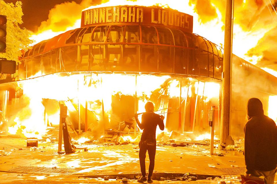 Protesters set a shop on fire on Thursday (local time) during the third day of protests over the death of George Floyd in Minneapolis. Source: Jordan Strowder/Anadolu Agency via Getty Images