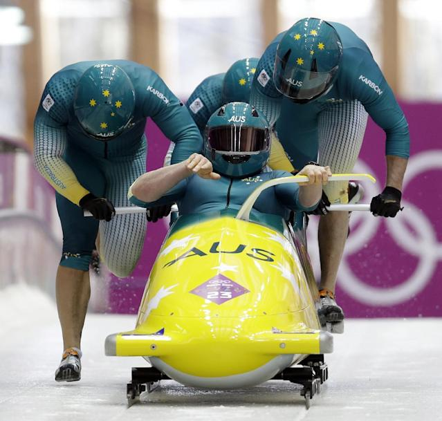 The team from Australia AUS-1, with Heath Spence, Gareth Nichols, Duncan Harvey, and Lucas Mata, start their third run during the men's four-man bobsled competition final at the 2014 Winter Olympics, Sunday, Feb. 23, 2014, in Krasnaya Polyana, Russia. (AP Photo/Natacha Pisarenko)
