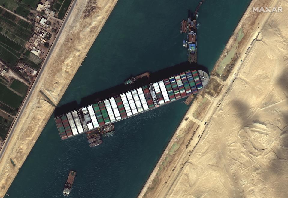 Satellite imagery of the Suez canal shows the container ship (Ever Given) stuck in the canal north of the city of Suez, Egypt. Photo: Satellite image (c) 2020 Maxar Technologies