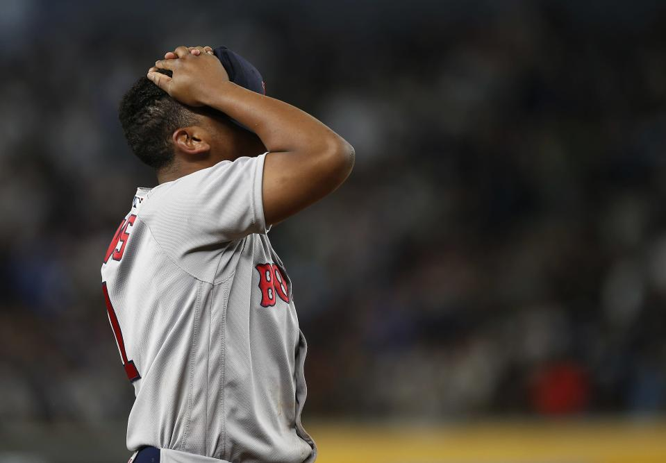 Third baseman Rafael Devers of the Boston Red Sox reacts to his throw on an infield single by Gary Sanchez of the New York Yankees during the sixth inning of a game at Yankee Stadium on September 3, 2017 in the Bronx borough of New York City. (Getty Images)
