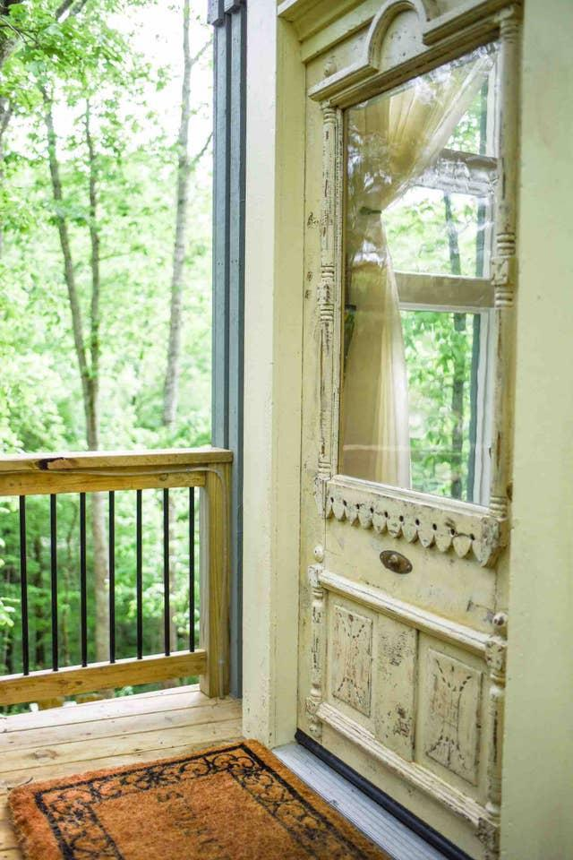 """The 170-year-old treehouse door had a former life in a Shelbyville, Tennessee mansion that operated as a hospital during the Civil War. Turn the 1899-manufactured doorbell for the same """"ring ring"""" heard 120 years ago. Photo credit: Susan Dyer."""