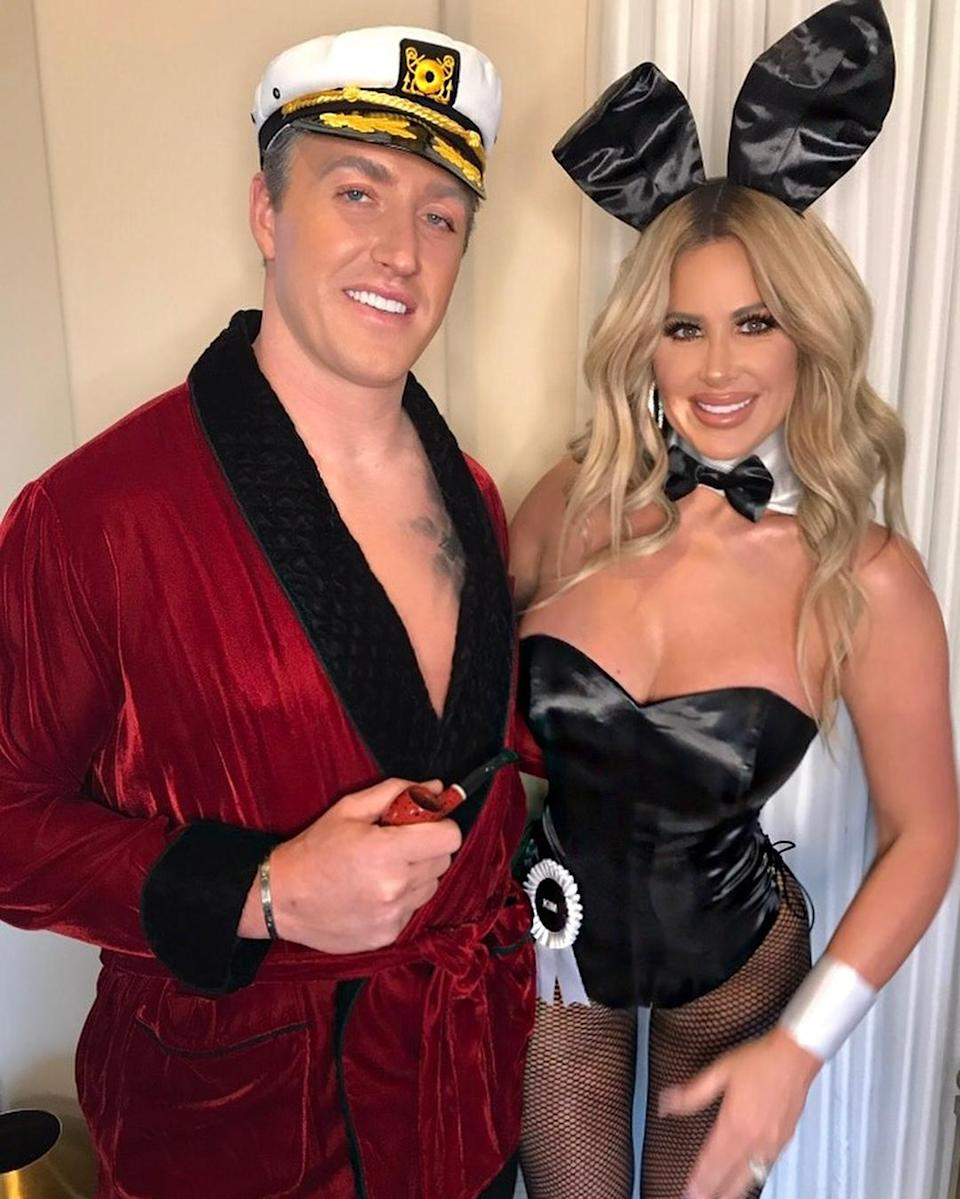 """<p>The <em>Real Housewives of Atlanta</em> star and her hubby dressed as late Playboy publisher Hugh Hefner and the woman she proclaimed as """"one of my fav Playmates of all time."""" It was the first time the two had ever dressed up together, Zolciak noted. (Photo: Instagram/Kim Zolciak-Biermann) </p>"""