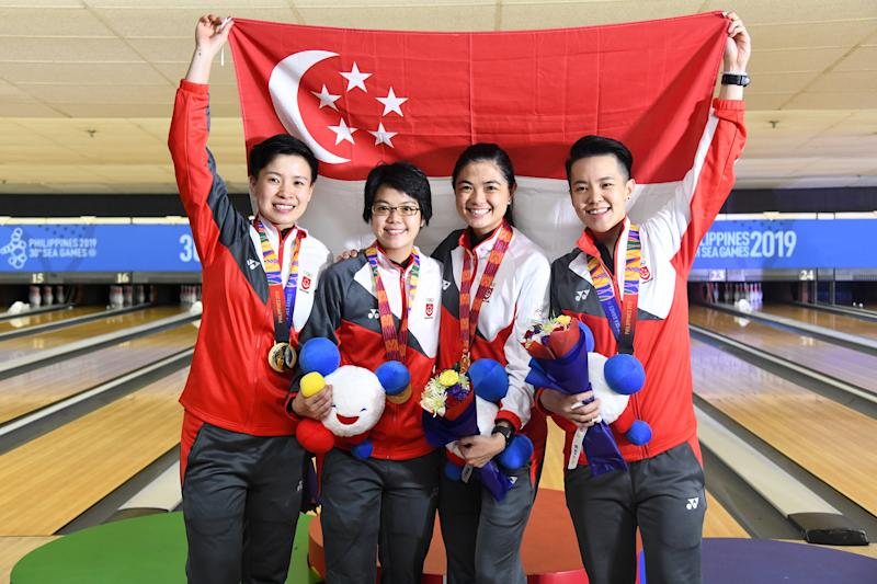 Singapore's women's bowling team – comprising (from left) New Hui Fen, Cherie Tan, Daphne Tan and Shayna Ng – clinched their first team gold since the 2011 SEA Games. (PHOTO: SNOC/Lim Weixiang)