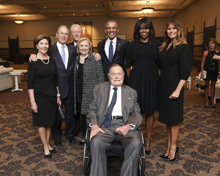 <p>This April 21, 2018, photo provided by the Office of former U.S. President George H.W. Bush shows Bush, front center, and past presidents and first ladies Laura Bush, from left, George W. Bush, Bill Clinton, Hillary Clinton, Barack Obama, Michelle Obama and current first lady Melania Trump in a group photo at the funeral service for former first lady Barbara Bush, in Houston. (Photo: Paul Morse/Courtesy of Office of George H.W. Bush via AP) </p>