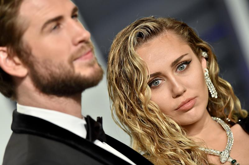 BEVERLY HILLS, CALIFORNIA - FEBRUARY 24: Miley Cyrus and Liam Hemsworth attend the 2019 Vanity Fair Oscar Party Hosted By Radhika Jones at Wallis Annenberg Center for the Performing Arts on February 24, 2019 in Beverly Hills, California. (Photo by Axelle/Bauer-Griffin/FilmMagic)