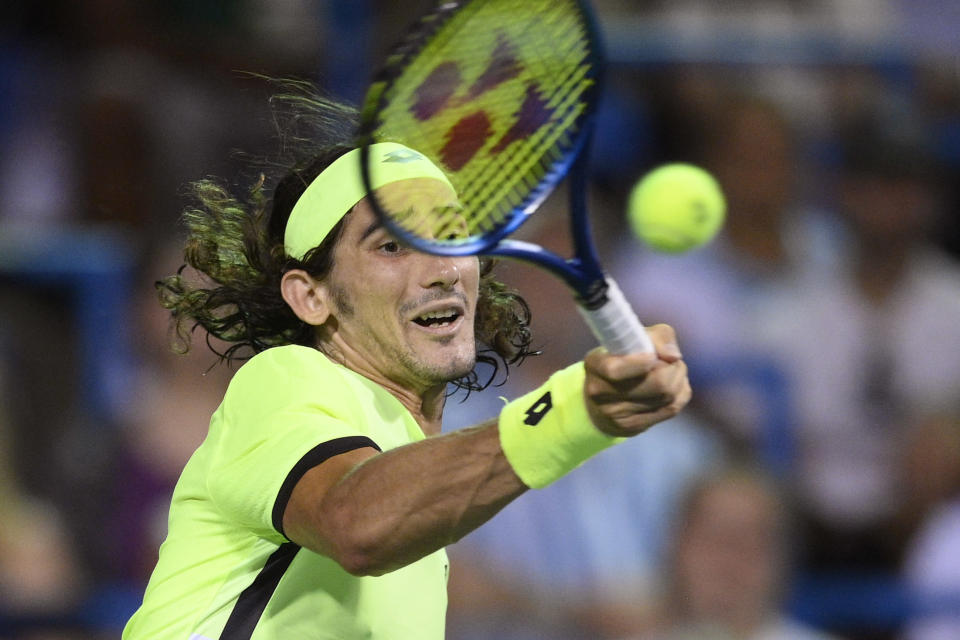 Lloyd Harris, of South Africa, hits a forehand to Rafael Nadal, of Spain, during the Citi Open tennis tournament Thursday, Aug. 5, 2021, in Washington. Harris won 6-4, 1-6, 6-4. (AP Photo/Nick Wass)