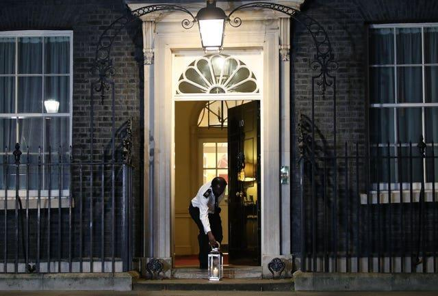 A candle is placed outside Downing Street, London, during the National Day of Reflection