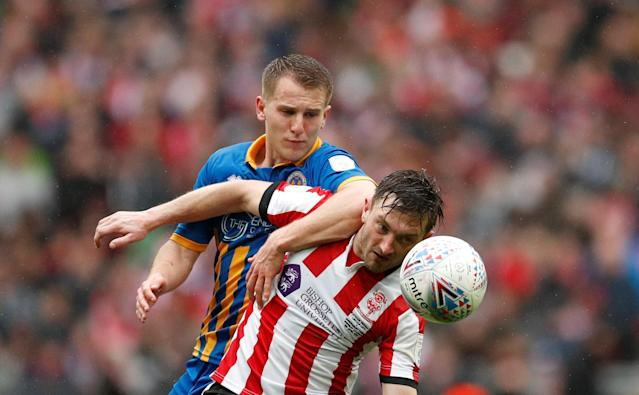 "Soccer Football - Checkatrade Trophy Final - Lincoln City vs Shrewsbury Town - Wembley Stadium, London, Britain - April 8, 2018 Shrewsbury Town's Bryn Morris in action with Lincoln City's Lee Frecklington Action Images/Andrew Boyers EDITORIAL USE ONLY. No use with unauthorized audio, video, data, fixture lists, club/league logos or ""live"" services. Online in-match use limited to 75 images, no video emulation. No use in betting, games or single club/league/player publications. Please contact your account representative for further details."