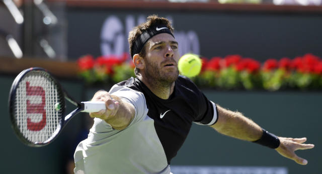 Juan Martin del Potro, of Argentina, returns a shot to Roger Federer, of Switzerland, during the men's final at the BNP Paribas Open tennis tournament, Sunday, March 18, 2018, in Indian Wells, Calif. (AP Photo/Mark J. Terrill)
